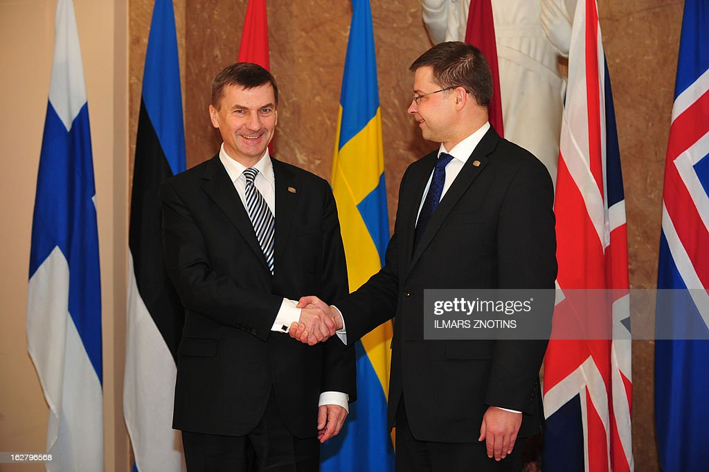 Latvian Prime Minister Valdis Dombrovskis (R) shake hands with his Estonian counterpart Andrus Ansip prior to the Northern Future Forum in Riga on February 27, 2013. The Northern Future Forum is an annual, informal meeting of prime ministers, policy innovators, entrepreneurs and business leaders from 9 nations.
