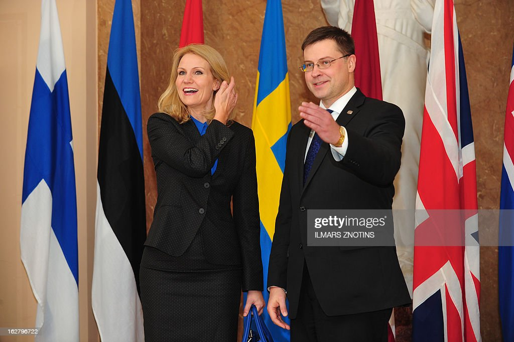 Latvian Prime Minister Valdis Dombrovskis (R) welcomes his Danish counterpart Helle Thorning-Schmidt prior to the Northern Future Forum in Riga on February 27, 2013. The Northern Future Forum is an annual, informal meeting of prime ministers, policy innovators, entrepreneurs and business leaders from 9 nations. AFP PHOTO / ILMARS ZNOTINS