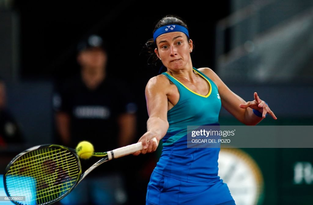 Latvian tennis player Anastasija Sevastova returns the ball to Romanian tennis player Simona Halep during the WTA Madrid Open semi final match in Madrid, on May 12, 2017. Halep won 6-2 and 6-3. /