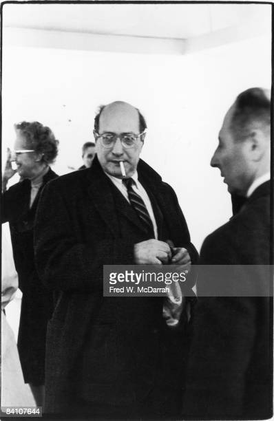Latvianborn American painter Mark Rothko smokes a cigarette at an unidentified event New York New York late 1950s or early 1960s