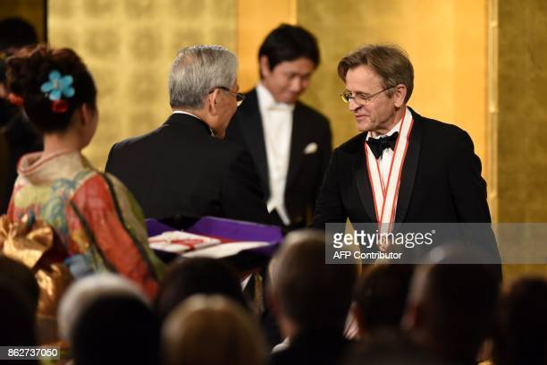 Latvianborn dancer and choreographer Mikhail Baryshnikov receives certification during the awards ceremony of the 29th Praemium Imperiale in Tokyo on...