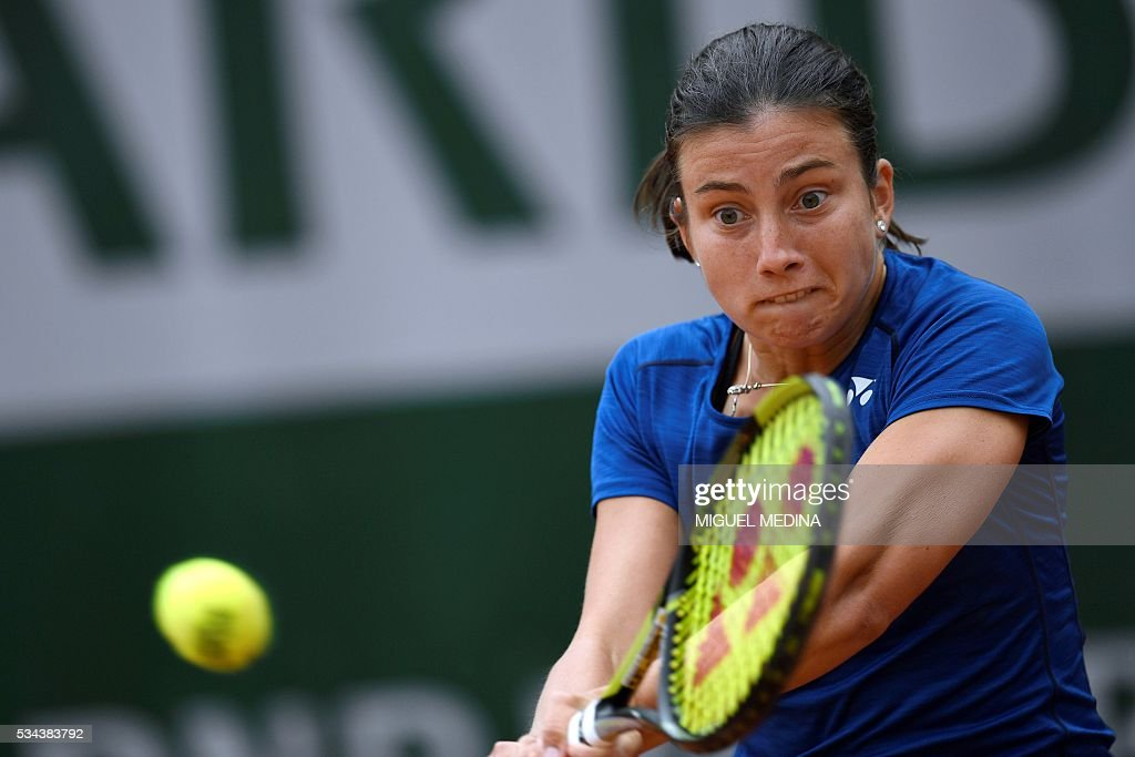 Latvia's Anastasija Sevastova returns the ball to Italy's Karin Knapp during their women's second round match at the Roland Garros 2016 French Tennis Open in Paris on May 26, 2016. / AFP / MIGUEL