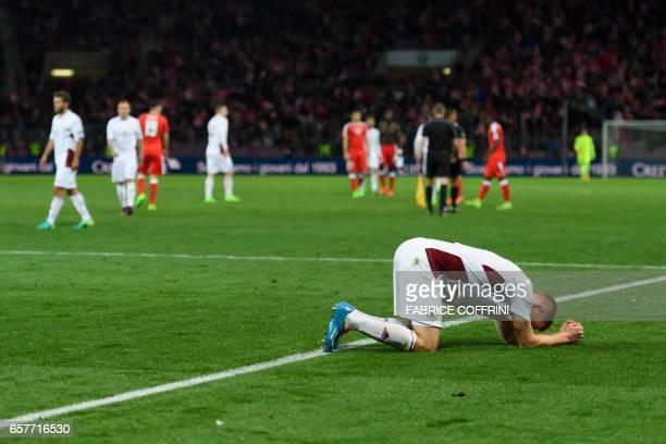 Latvia's defender Gints Freimanis reacts after losing the FIFA World Cup 2018 qualifying football match between Switzerland and Latvia on March 25 at...