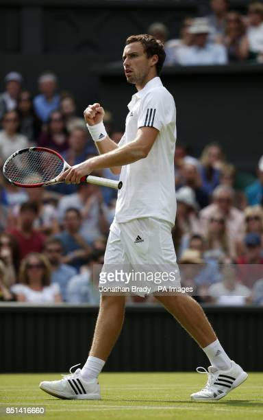 Latvia's Ernests Gulbis celebrates a point against France's JoWilfried Tsonga during day Three of the Wimbledon Championships at The All England Lawn...