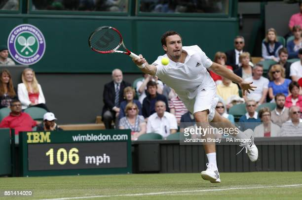 Latvia's Ernests Gulbis in action against France's JoWilfried Tsonga during day Three of the Wimbledon Championships at The All England Lawn Tennis...