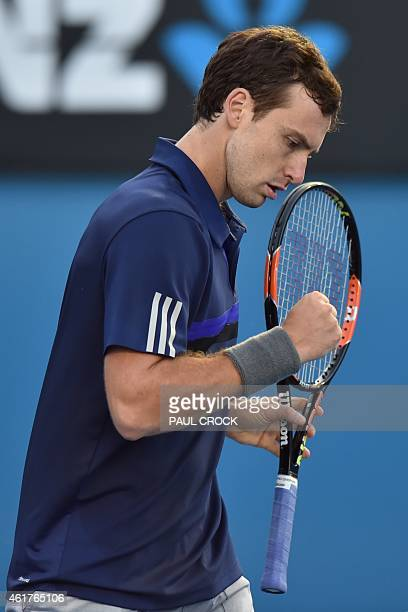 Latvia's Ernests Gulbis reacts as he plays Australia's Thanasi Kokkinakis during their men's singles match on day one of the 2015 Australian Open...