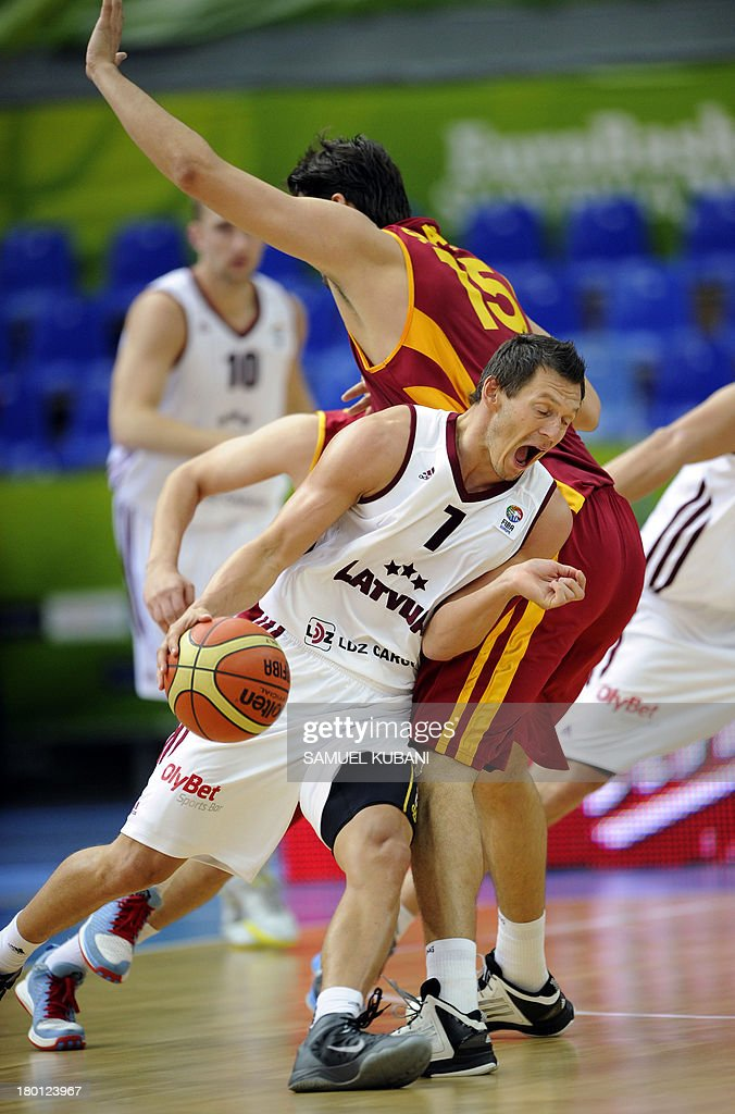 Latvia's Janis Blums (front) challenges Macedonia's Predrag Samardziski during the 2013 EuroBasket Championship group B match between F.Y.R. Macedonia and Latvia in Jesenice on September 9, 2013.