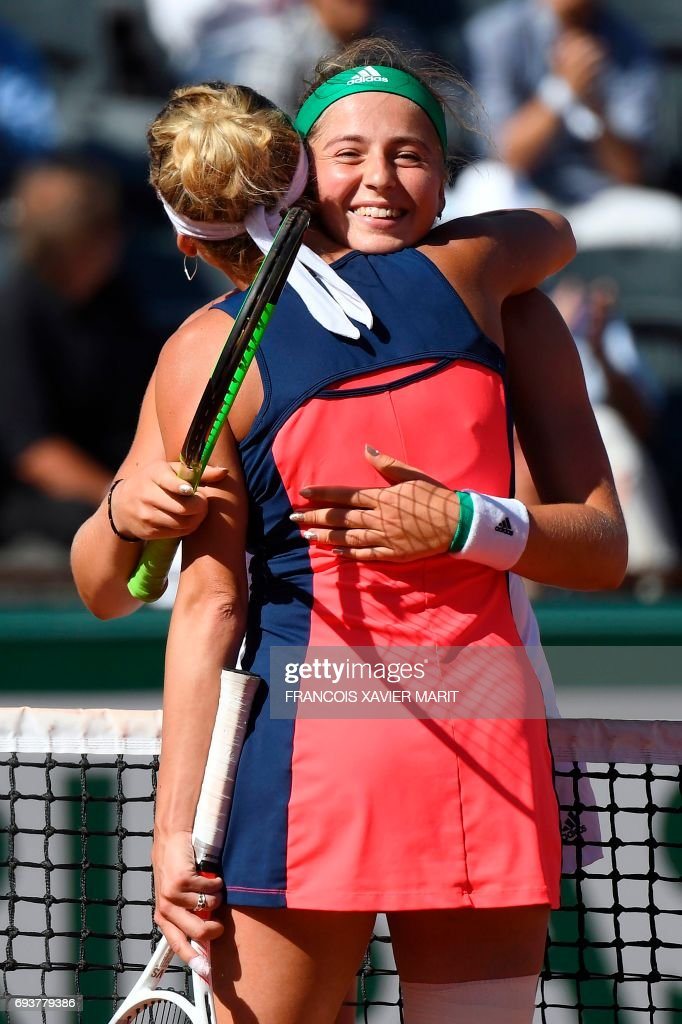 Latvia's Jelena Ostapenko (R) is congratulated by Switzerland's Timea Bacsinszky after winning their semifinal tennis match at the Roland Garros 2017 French Open on June 8, 2017 in Paris. /