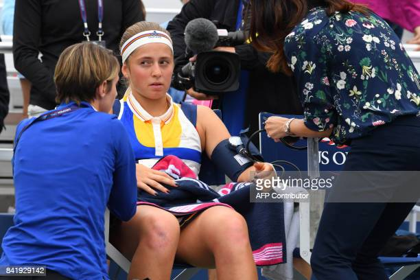 Latvia's Jelena Ostapenko is treated by a doctor who checks her blood pressure during her Qualifying Women's Singles match against Russia's Darya...