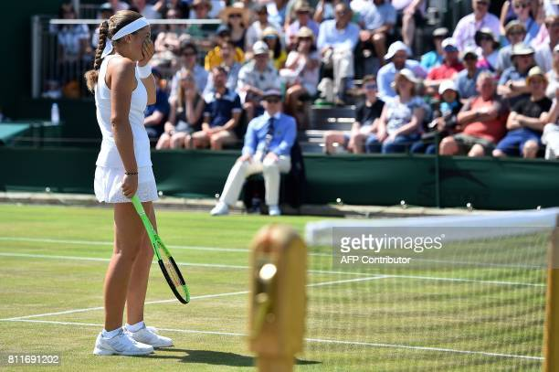 Latvia's Jelena Ostapenko reacts against Ukraine's Elina Svitolina during their women's singles fourth round match on the seventh day of the 2017...