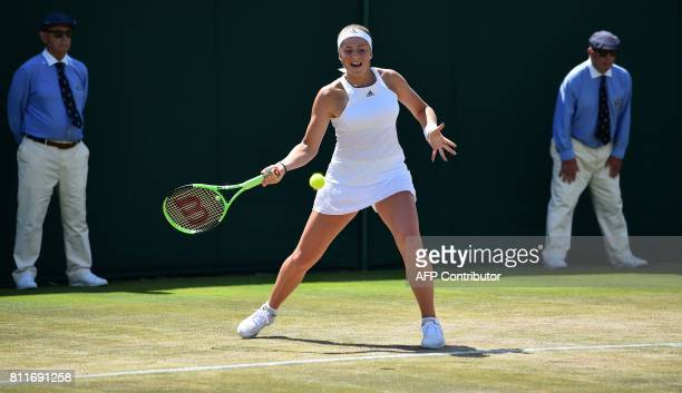 Latvia's Jelena Ostapenko returns against Ukraine's Elina Svitolina during their women's singles fourth round match on the seventh day of the 2017...