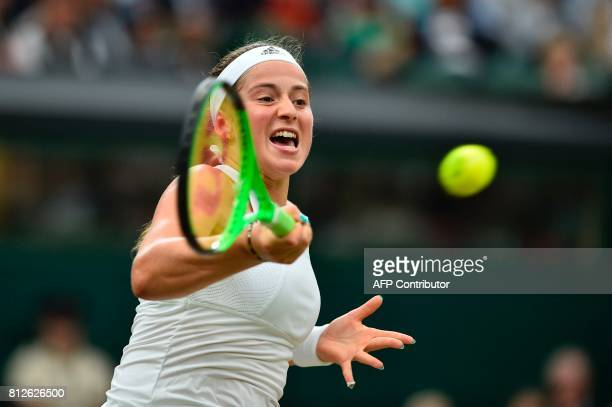 Latvia's Jelena Ostapenko returns against US player Venus Williams during their women's singles quarterfinal match on the eighth day of the 2017...