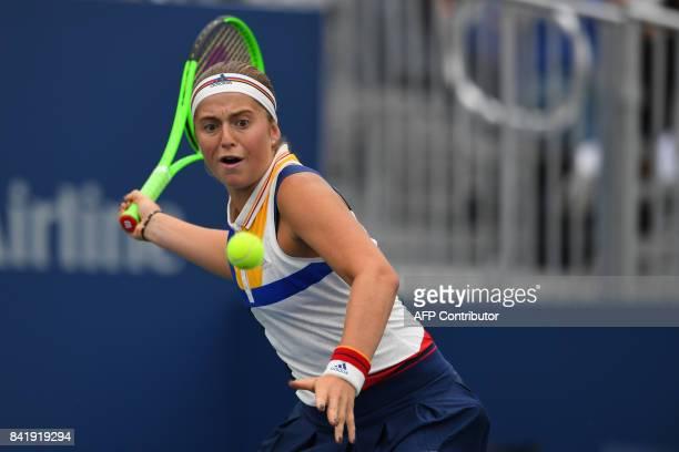 Latvia's Jelena Ostapenko returns the ball to Russia's Darya Kasatkina during their Qualifying Women's Singles match at the 2017 US Open Tennis...
