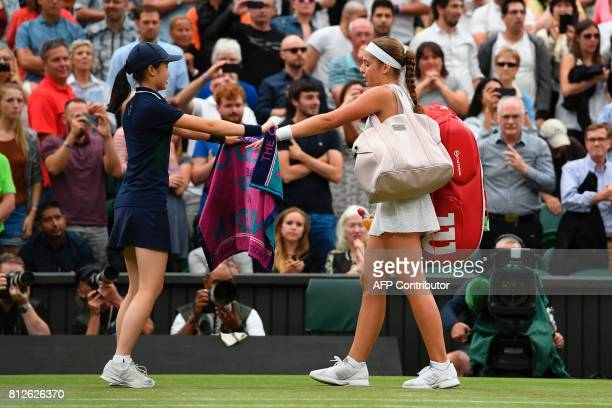 Latvia's Jelena Ostapenko takes her towel as she leaves the court after losing to US player Venus Williams in their women's singles quarterfinal...