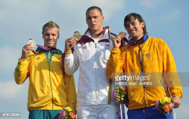 Latvia's Maris Strombergs celebrates gold in the BMX with silver medalist Australia's Sam Willoughby and Bronze Medalist Columbia's Carlos Mario...