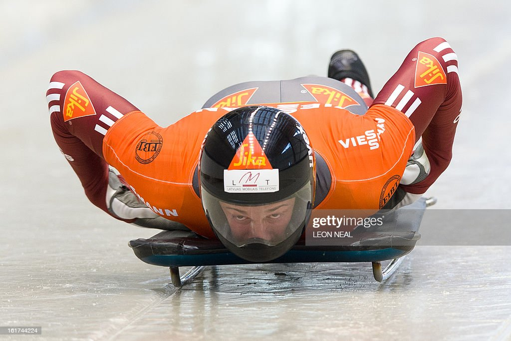 Latvia's Martins Dukurs takes part in the first run of the FIBT Bob and Skeleton World Cup 2012/13 event at the Sanki Sliding Centre, some 50 km from Russia's Black Sea resort of Sochi, on February 15, 2013. Dukurs went on to win the FIBT Skeleton World Cup 2012/13 after a successful second run. With a year to go until the Sochi 2014 Winter Games, construction work continues as tests events and World Championship competitions are underway. AFP PHOTO / LEON NEAL