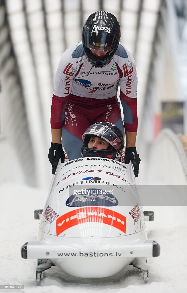 Latvia's Oskars Melbardis takes the gold medal at the 4-man Bobsleigh event at the FIBT Bob & Skeleton World Cup at the Sanki Sliding Centre, some 50 km from Russia's Black Sea resort of Sochi, on February 17, 2013. Russia's Alexander Zubkov came joint third and won the overall championship. With a year to go until the Sochi 2014 Winter Games, construction work continues as tests events and World Championship competitions are underway.
