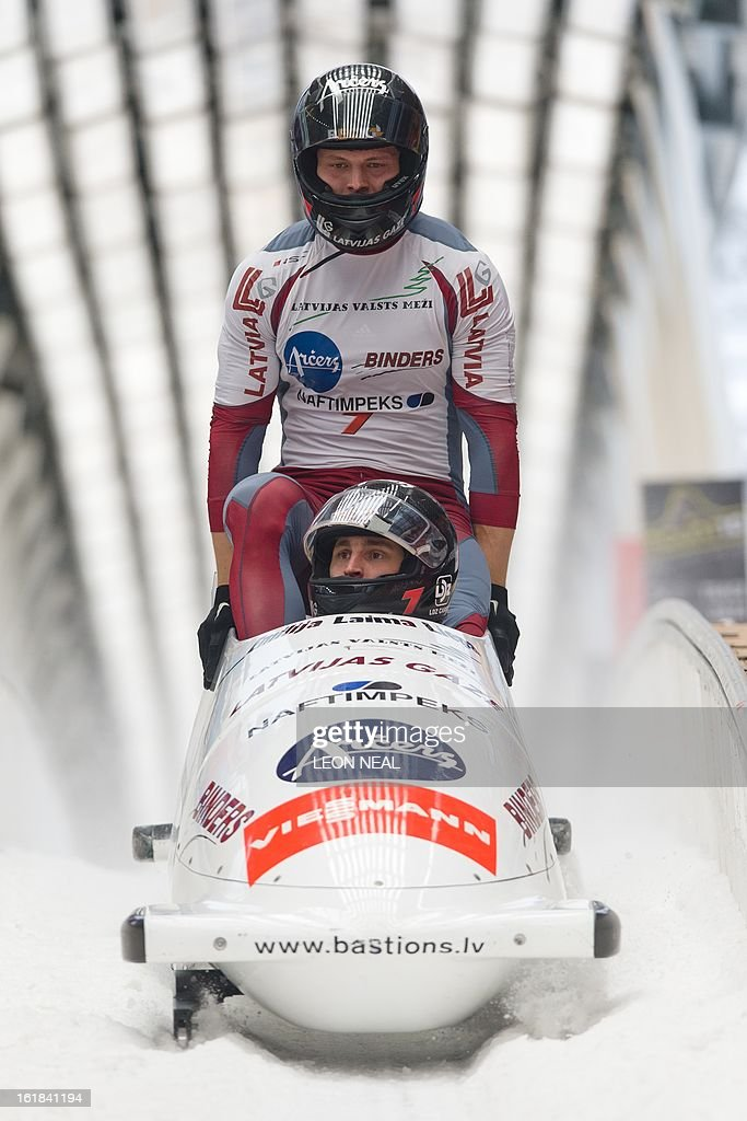 Latvia's Oskars Melbardis takes the gold medal at the 4-man Bobsleigh event at the FIBT Bob & Skeleton World Cup at the Sanki Sliding Centre, some 50 km from Russia's Black Sea resort of Sochi, on February 17, 2013. Russia's Alexander Zubkov came joint third and won the overall championship. With a year to go until the Sochi 2014 Winter Games, construction work continues as tests events and World Championship competitions are underway. AFP PHOTO / LEON NEAL