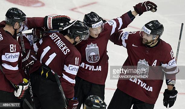Latvia's players celebrate after scoring during a preliminary round group B game Germany vs Lavia of the IIHF International Ice Hockey World...