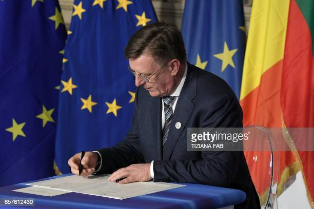 Latvia's Prime Minister Maris Kucinskis signs the new Rome declaration with leaders of 27 European Union countries special during a summit of EU...