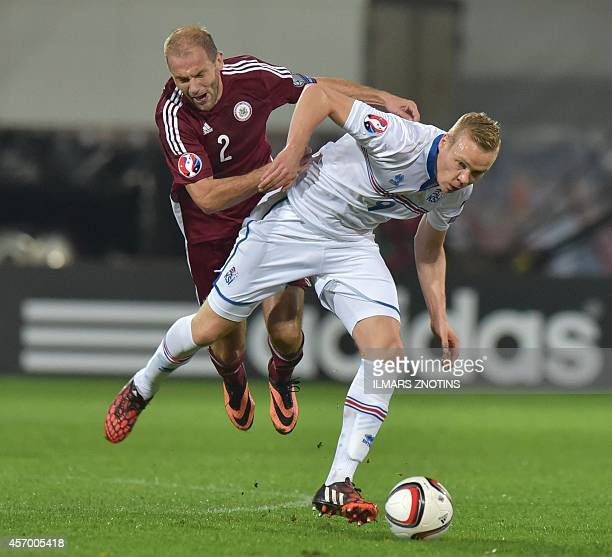Latvia's Viktors Morozs vies with Iceland's Kolbein Sigthorsson during their Euro 2016 qualifier football match Latvia vs Iceland in Riga on October...