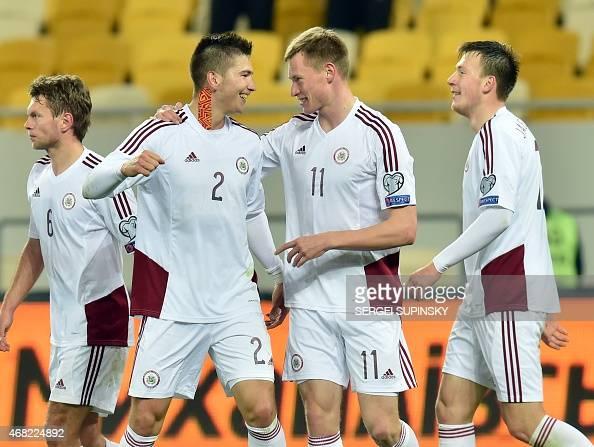 Latvia's Vitalijs Maksimenko celebrates after scoring a goal during the friendly football match Ukraine vs Latvia in Lviv on March 31 2015 AFP PHOTO/...