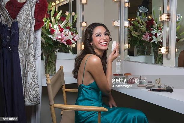 Laughing actress in dressing room