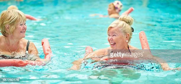 laughing and joking senior water aerobics