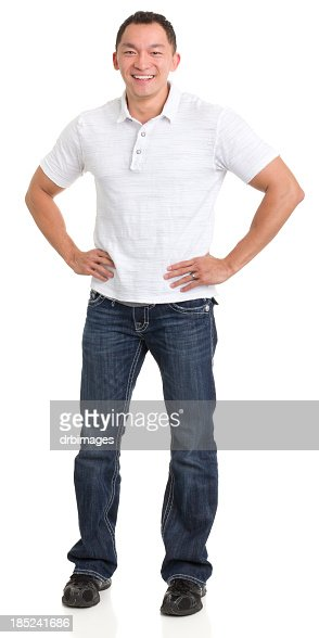 Laughing Asian Man With Hands On Hips