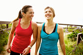 Laughing athletic friends standing together outdoors