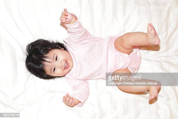 Laughing baby on Soft Bed