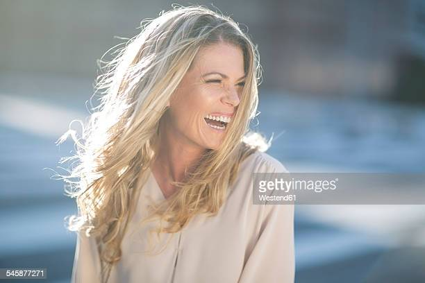 Laughing blond woman outdoors