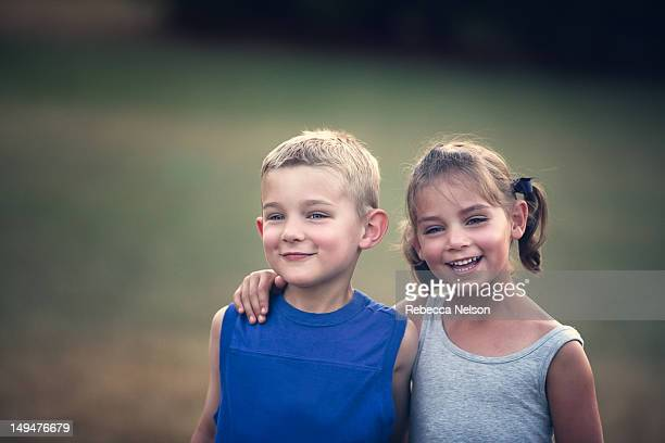 Laughing boy and girl twins