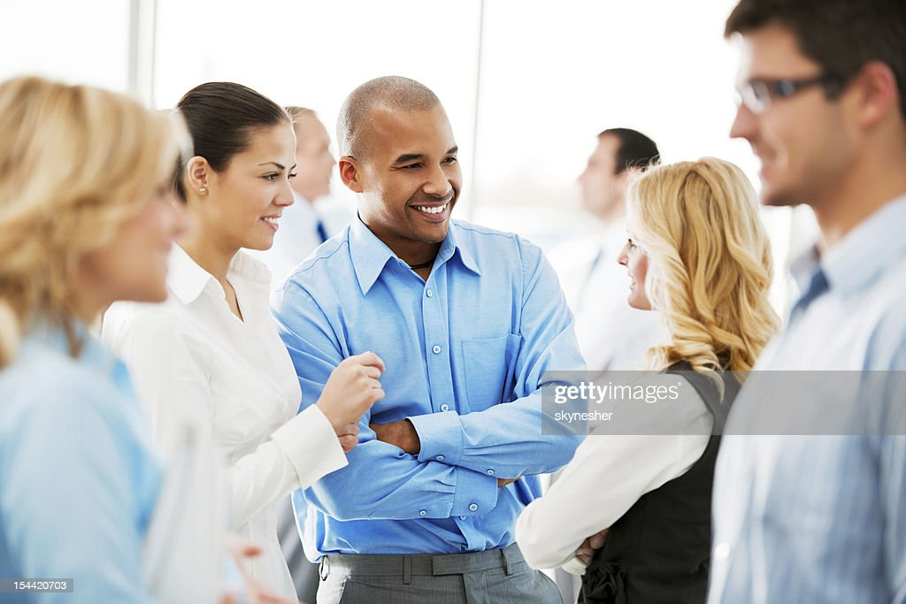 Laughing  businesspeople talking in the office. : Stock Photo