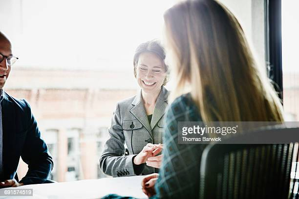 Laughing businesswoman in team meeting