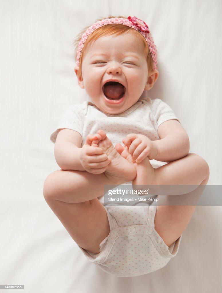 Laughing Caucasian baby girl