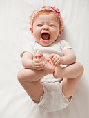 Laughing Caucasian baby girl
