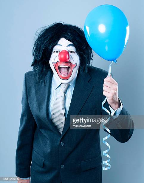 Laughing clown dressed in a suit