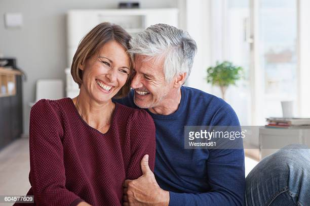 Laughing couple at home
