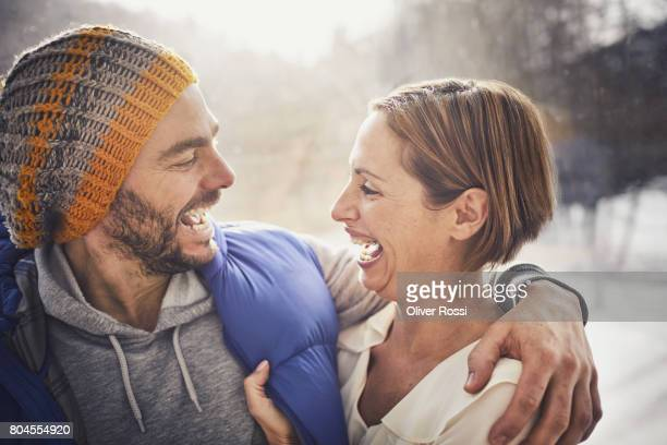Laughing couple embracing