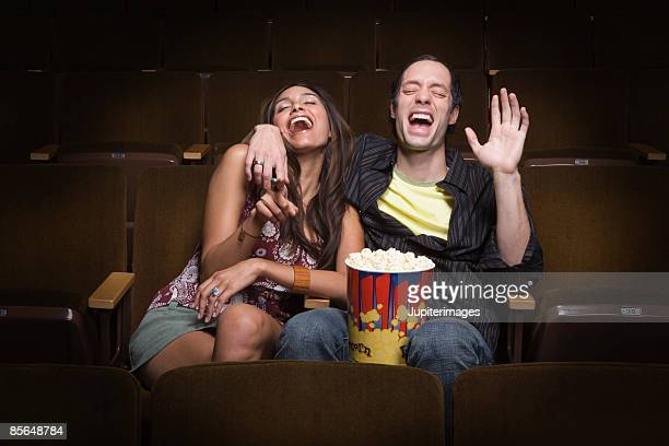 Laughing couple in movie theatre