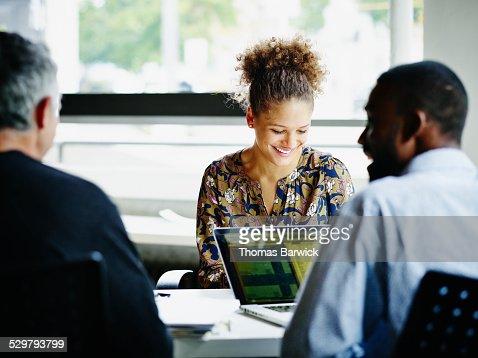 Laughing coworkers in informal meeting in office