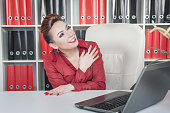 Laughing crazy business woman working in office