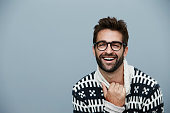 Laughing dude in sweater, studio