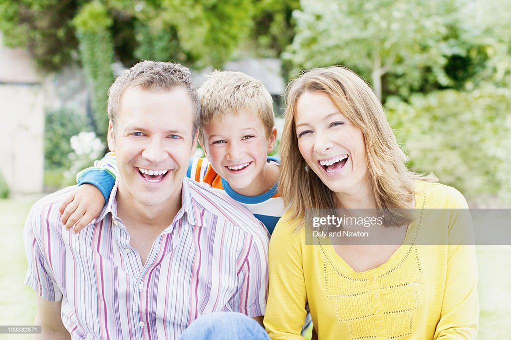 Laughing family in backyard : Stock Photo
