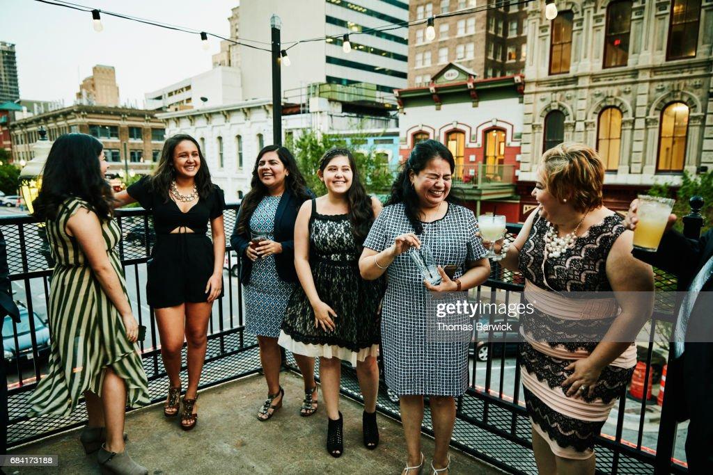 Laughing female family members on restaurant deck before dinner : Stock Photo