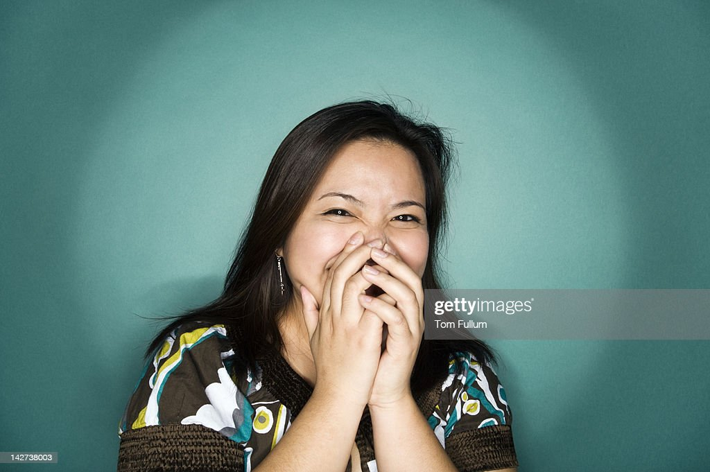 Laughing Filipina woman : Stock Photo