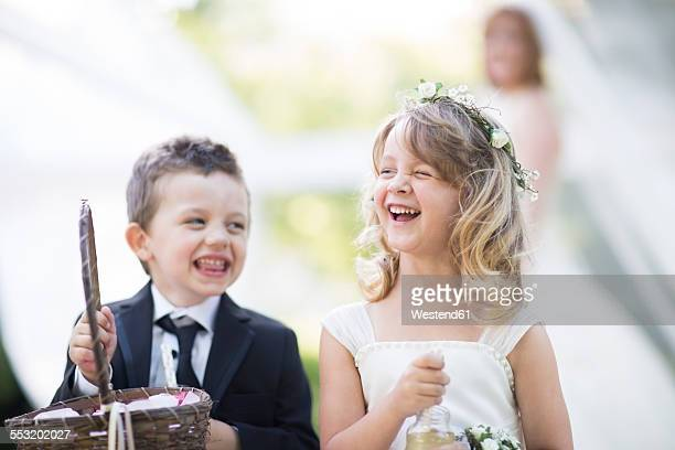 Laughing flower girl and boy at a wedding