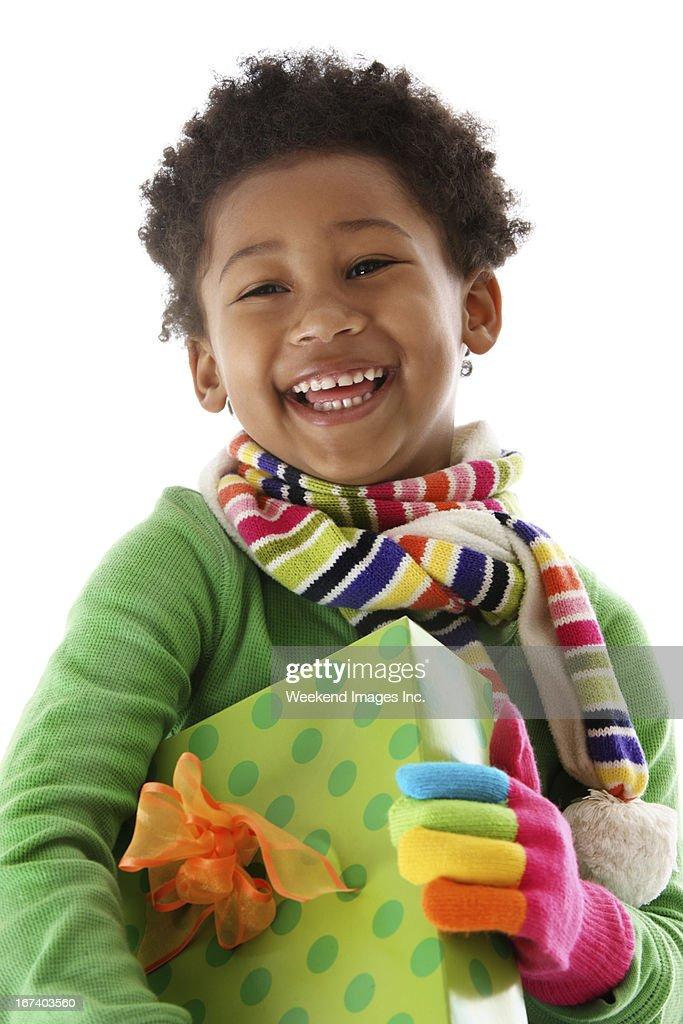 Laughing girl   with Christmas gift : Stockfoto