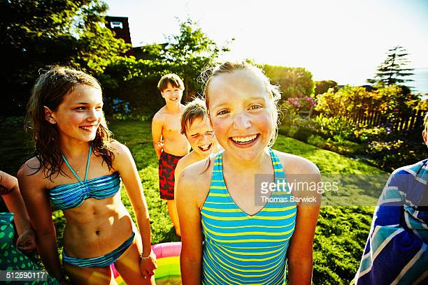 Laughing girl with friends in backyard